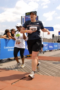 "Look at me finishing my first half marathon in Brooklyn. That is an, ""Oh thank god this is over"" look. Also, I think I felt as though I were going to die."