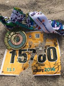 My medal and bib earned a trip to the beach. (c) Stacey Cooper